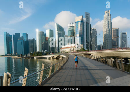 People jogging at morning in Singapore business district skyline financial downtown building with tourist sightseeing in day at Marina Bay, Singapore. - Stock Photo