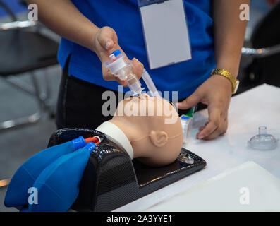 using emergency tool resuscitator with mannequin dummy - Stock Photo