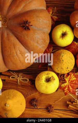 A bunch of pumpkins and apples. Autumn Colored Pumpkins On Wooden Table. - Stock Photo
