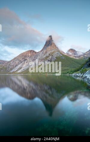 Stetind is reflected in Fjord, Norwegian National Mountain, Tysfjord, Ofoten, Nordland, Norway - Stock Photo