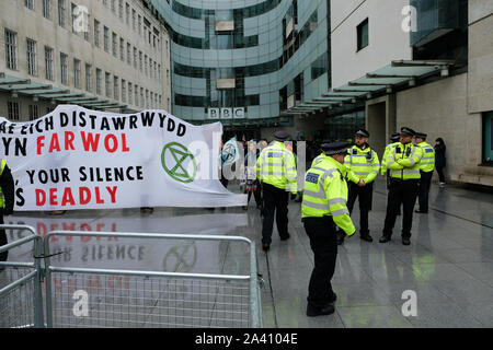 BBC, Portland Place, London, UK. 11th Oct, 2019. Extinction Rebellion protesters outside the BBC in London. Credit: Matthew Chattle/Alamy Live News - Stock Photo