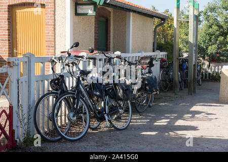 Le Crotoy, Picardy, France, cycles tied up at the station, Chemin de Fer de la Baie de Somme, electric cycles - Stock Photo