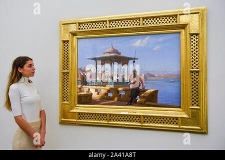 London, UK.  11 October 2019. A staff member views 'The Harem in the Kiosk', by Jean-Léon Gérôme, (Est GBP3-5m).  Preview of works from the Najd Collection of orientalist paintings at Sotheby's in New Bond Street, which record daily life in the historic Arab, Ottoman and Islamic worlds  All 155 paintings are on public view 11- 15 October, with 40 works to be auctioned on 22 October.  Credit: Stephen Chung / Alamy Live News