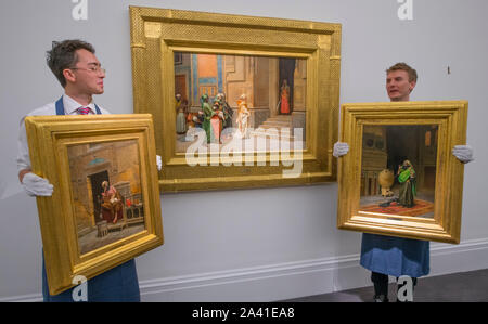 Sotheby's, New Bond Street, London, UK. 11th October 2019. Sotheby's Orientalist & Middle Eastern Week encompasses important works from the Najd Collection, The Shakerine Collection, 20th Century Art/Middle East, and Arts of the Islamic World before the sales on 22 & 23 October. Image (centre): Rudolf Ernst. The New Bride, estimate £400,000-600,000; (left): Ludwig Deutsch. The Scribe, estimate £800,000-1,200,000; (right): Ludwig Deutsch. The Morning Prayer, estimate: £700,000-1,000,000. Credit: Malcolm Park/Alamy Live News. - Stock Photo
