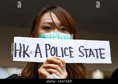 Hong Kong. 11th October 2019. Lunchtime flash mob demonstration by Pro-democracy demonstrators in Chater Square , Central District in Hong Kong. The protestors gathered to protest about treatment of those arrested by the police during Pro-democracy protests in the last 4 months. Police threatened to stop demonstration but it passed peacefully and concluded with march through city streets . Iain Masterton/Alamy Live News. - Stock Photo