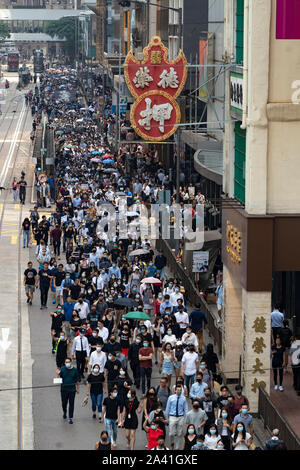 Hong Kong, China. 11th October 2019. Lunchtime flash mob demonstration by Pro-democracy demonstrators in Chater Square , Central District in Hong Kong. The protestors gathered to protest about treatment of those arrested by the police during Pro-democracy protests in the last 4 months. Police threatened to stop demonstration but it passed peacefully and concluded with march through city streets . Iain Masterton/Alamy Live News. - Stock Photo