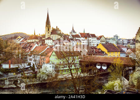 Sunset over the old town of Baden city in Switzerland - Stock Photo
