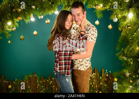 couple in love near christmas background. Young couple kissing near Christmas tree. Low key. Silhouette - Stock Photo