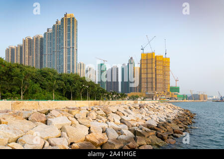 View of new  dense urban high-rise apartment buildings in LOHAS Park new housing estate in New Territories of Hong Kong, China. - Stock Photo