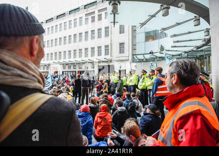 London, UK. 11 October 2019.  Members of Extinction Rebellion gather outside the headquarters of BBC at Portland Place on day 5 of their demonstrations.  Climate activists are demanding that the government takes immediate action against the negative effects of climate change. Credit: Stephen Chung / Alamy Live News - Stock Photo