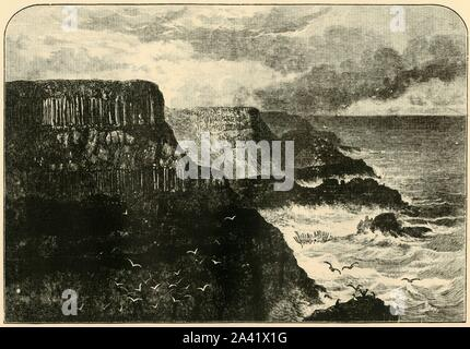 "'Pleaskin Head, Anrim', 1898. Pleaskin Head on the Atlantic Ocean at the Giant's Causeway in County Antrim with interlocking volcanic basalt columns, is listed as a World Heritage Site. From ""Our Own Country, Volume V"". [Cassell and Company, Limited, London, Paris & Melbourne, 1898] - Stock Photo"