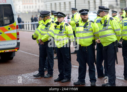 London, England, UK. Metropolitan Police policing a demonstration by Extinction Rebellion outside the Treasury Building in Westminster, October 2019 - Stock Photo