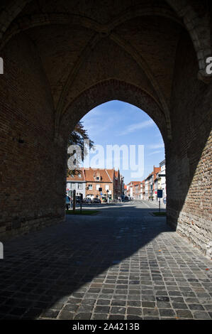 Looking through the medieval Gentpoort (Gate of Ghent) entrance to Bruges, Belgium. - Stock Photo