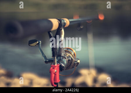Fishing rod with a blurred background on a beautiful sunny day - Stock Photo