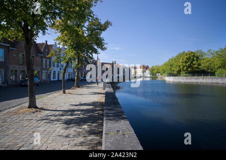 A typical canal-side scene in Bruges, Belgium, on a sunny day. - Stock Photo