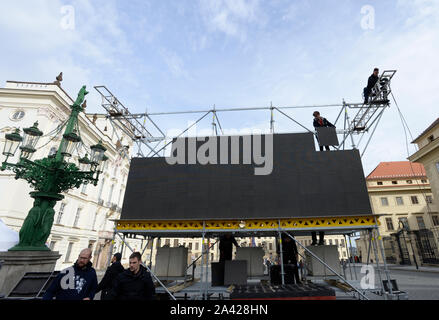 The instalation of the large-scale screen on Hradcany square outside the Prague Castle, Prague, Czech Republic, October 11, 2019. On Saturday, October 12, a mourning ceremony will take place in St Vitus Cathedral at the Prague Castle, the seat of Czech kings and presidents, at 11:00. The heritage site will be partially closed to the public until 14:00 over the event that will be for invited guests only. The public can watch it on large-scale screens. Czech pop singer Karel Gott died at 80 on October 1, 2019, before midnight at home in his family circle. Gott was at the top of music for some 60 - Stock Photo