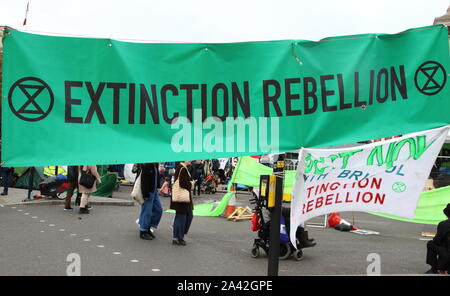 London, UK. 10th Oct, 2019. An Extinction Rebellion banner during the protest.Extinction Rebellion demonstrators protest at the Trafalgar Square and Whitehall to highlight the 'climate emergency' facing the planet. Credit: SOPA Images Limited/Alamy Live News - Stock Photo