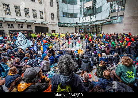 London, UK. 11th Oct 2019. XR Wales blockade the BBC Broadcasting House in Portland Place because they believe they have been slow to speak up on climate change - The fifth day of the Extinction Rebellion October action which has blocked roads in central London. They are again highlighting the climate emergency, with time running out to save the planet from a climate disaster. the 'climate crisis'. Credit: Guy Bell/Alamy Live News - Stock Photo