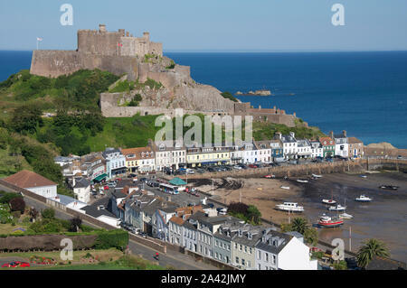 Scenic coastal view overlooking the historic medieval Mont Orgueil Castle and the picturesque village and harbour of Gorey. Jersey, Channel Islands.