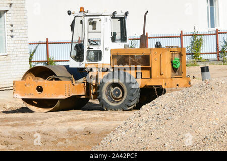Heavy vibratory roller. road stacker. Orange color. - Stock Photo