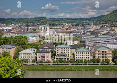 Beautiful view of the old town and the Salzach river and the garden in Schloßpark Mirabell in Salzburg with Barockmuseum and church St. Andrä, Austria - Stock Photo
