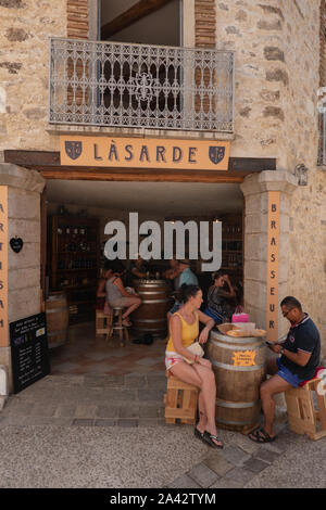 cafe in medieval village of Saint-Guilhem-le-Desert Herault Occitanie France - Stock Photo