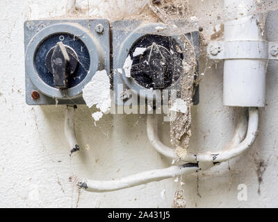 Old switch on a wall - Stock Photo