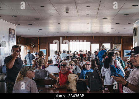 Delos, Greece- September 20, 2019: People waiting to disembark Delos Tours boat that has just arrived to to the island of Delos, a famous archaeologic - Stock Photo