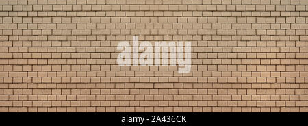 Old brick wall, completely painted over with beige paint - Stock Photo