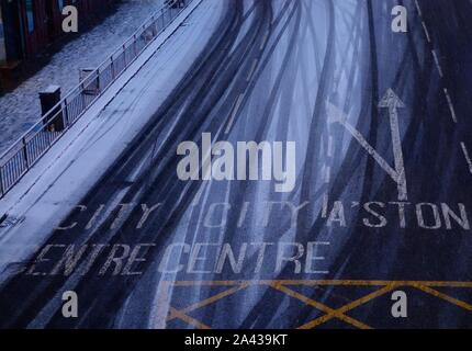 Snow on the road, Glasgow - Stock Photo