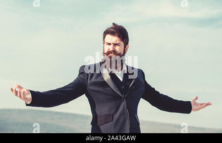 Feeling undefeated. Self proud and narcissistic. Hipster bearded attractive enjoy freedom. Guy enjoy top achievement. Man bearded proud himself sky background. Superiority and power. Proud of himself. - Stock Photo
