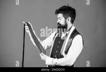 The tie is just the ticket for any menswear outfits. Bearded man choosing neck tie. Brutal hipster holding colorful tie collection. Find yourself a unique tie and mens accessories. - Stock Photo