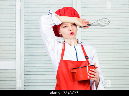 Start slowly whisking or beating cream. Confectionery and patisserie. Whipping cream tips and tricks. Butter cream. Use hand whisk. Woman chef hold whisk and pot. Girl in apron whipping eggs or cream. - Stock Photo