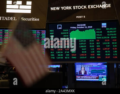 New York, USA. 11th Oct, 2019. Electronic screens show the trading data at the New York Stock Exchange in New York, the United States, on Oct. 11, 2019. U.S. stocks rallied on Friday. The Dow closed up 1.21 percent to 26,816.59, the S&P 500 rose 1.09 percent to 2,970.27, and the Nasdaq increased 1.34 percent to 8,057.04. Credit: Guo Peiran/Xinhua/Alamy Live News - Stock Photo