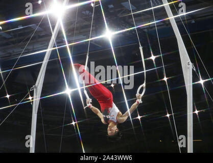 Kazuma Kaya of Japan performs on the rings in the men's individual all-around final at the artistic gymnastics world championships in Stuttgart, Germany, on Oct. 11, 2019. Kaya finished sixth. (Kyodo)==Kyodo Photo via Credit: Newscom/Alamy Live News
