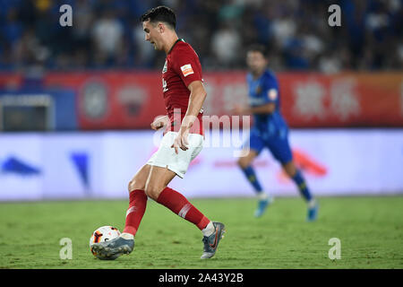 English-born Taiwanese football player Tim Chow of Henan Jianye dribbles against Jiangsu Suning in their 22nd round match during the 2019 Chinese Foot - Stock Photo
