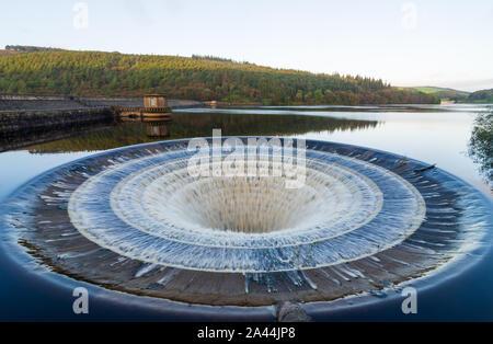 Plug hole overflow in Ladybower reservoir in the Peak District, Derbyshire, UK - Stock Photo