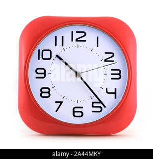 Small red alarm clock isolated on white background - Stock Photo