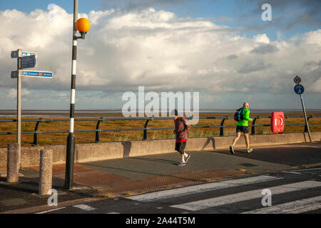 Southport, Merseyside. UK Weather. 12th October, 2019. Early morning rain for joggers running on the resort seafront promenade resort. Credit: MediaWorldImages/Alamy Live News - Stock Photo