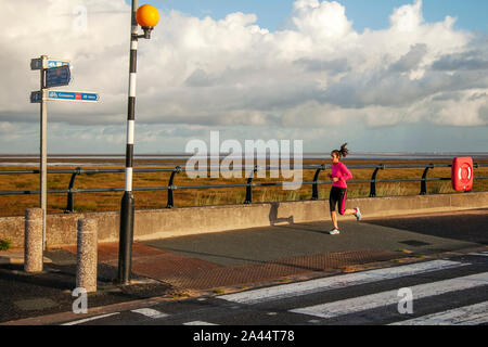 Southport, Merseyside. UK Weather. 12th October, 2019. Early morning rain for joggers, followed by brighter conditions in resort. Credit: MediaWorldImages/Alamy Live News - Stock Photo
