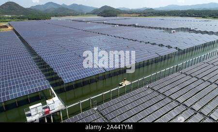 Aerial view of solar panels set at a fishing ponds, where fishermen continues fishing, in Dongxiang village, Fuzhou city, east China's Jiangxi provinc - Stock Photo