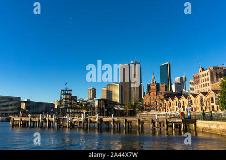 Sydney, Australia - Jul 23, 2016: Campbells Cove Jetty and Sydney Central Business District skyline in The Rocks precinct, which has State heritage si - Stock Photo