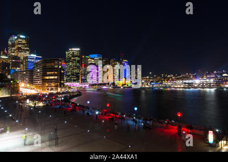 Sydney, Australia - 2016, May 27: Circular Quay and Sydney CBD skyscrapers illumination on annual outdoor lighting festival Vivid Sydney: Festival of - Stock Photo