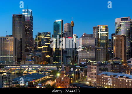 Sydney, Australia - Jul 23, 2016: Central Business District cityscape, skyline with skyscrapers of office buildings and Circular Quay ferry and train - Stock Photo