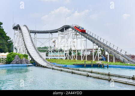 A rollar coaster with passengers is ''surfing'' in Guilin Merryland Theme Part in Guilin city, south China's Guangxi Zhuang Autonomous Region, 25 Augu - Stock Photo