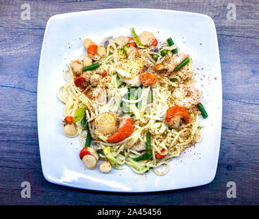 A delicious plate of Isle of Man Queen scallops and pasta in a creamy sauce - Stock Photo