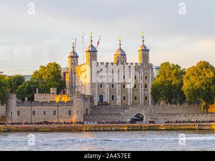 LONDON, UK - 24TH AUGUST 2019: Tower of London towards sunset from the River Thames. This famous building is a popular attraction and home of the Crow - Stock Photo