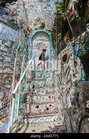 Magic Gardens Philadelphia, view of a young woman exploring the mosaics in Philadelphia's Magic Gardens, Philadelphia, Pennsylvania, PA, USA. Stock Photo