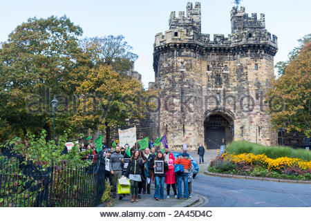 Lancaster, Lancashire, England, UK, 12 October 2019, protestors from the Morecambe Bay Extinction Rebels Group (associated with Extinction Rebellion) march from Lancaster Castle to the city's Market Square for a 'die in'. The protest coincides with other similar events all over the UK with the main Extinction Rebellion protest in London reaching the end of its first week. Credit: Keith Douglas News/Alamy Live News - Stock Photo