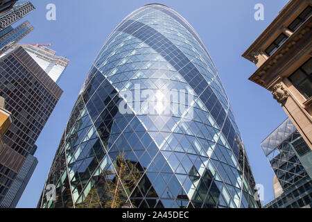 30 St Mary Axe (known previously as the Swiss Re Building) informally known as The Gherkin, is a commercial skyscraper in London, England. - Stock Photo